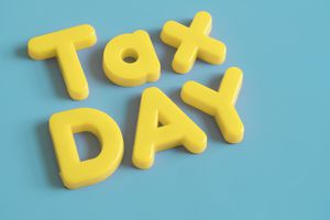 Tax Day Bright Yellow Letters on Blue
