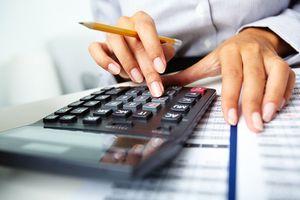 Person using adding calculator