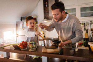 Father and young son in kitchen.