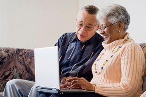 Older Black couple using a laptop