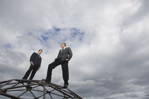 Two finance professionals stand on top of a geodesic dome.