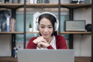 close-up shot of a young businesswoman working with video conference at home