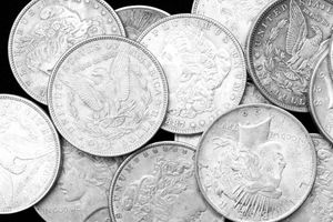 A pile of US silver dollars