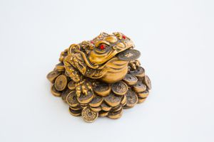 Feng shui money frog on a white background