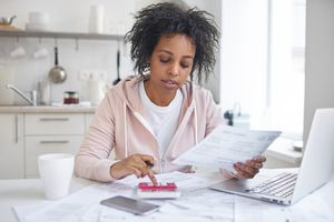 Woman reviewing finances for student loan deferment