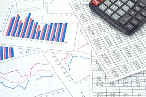 An image of financial tables graphs numbers for work business and economics.