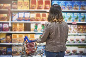 A shopper looking at brands in grocery store