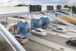 Cars travelling through toll booth at bridge, high angle view