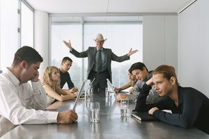 Businessman Talking to Bored Staff in Meeting