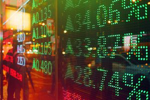 Stock exchange market display screen board on the street showing stock rises in green colour