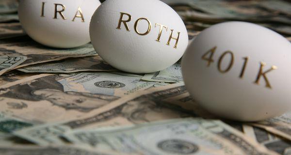 Eggs stamped IRA, Roth, 401K resting on $20 bills