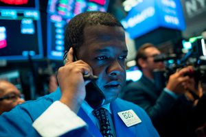 Traders work after the opening bell at the New York Stock Exchange (NYSE)
