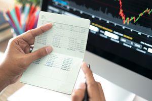 Hands Holding Saving Account Passbook, Book Bank Laptop Background