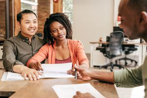 Couple getting a loan from a bank officer