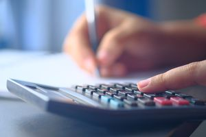 Accountant Hands Counts on the Calculator