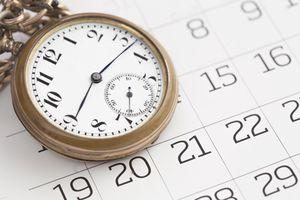 Large pocket watch on calendar