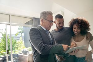 Insurance agent speaking with couple