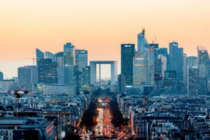 Elevated view of illuminated skyscrapers at La Defense financial district and Avenue des Champs-Elysees at dusk, Paris, France