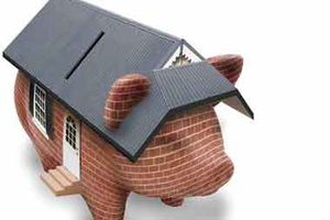 A piggy bank with a roof on top.