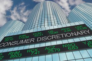 A sign with stock markers reading consumer discretionary