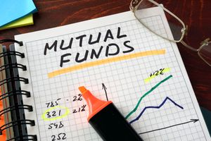 A notebook with mutual funds sign on a table.