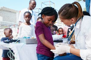 Volunteer nurses giving checkups to underprivileged kids.