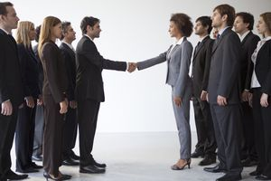 Business leaders shaking hands in agreement.
