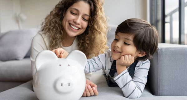 Happy family saving money in a piggybank
