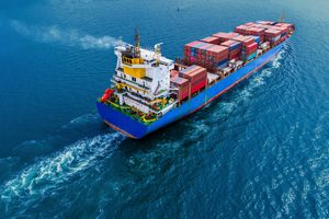Container ship moving in the water