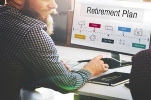 Man at computer with retirement plan on screen