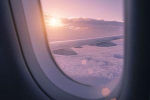 Beautiful sunset through an airplane window