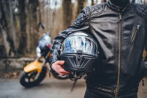 Motorcyclist with his helmet
