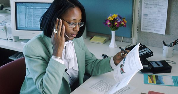 Young Black professional woman at desk
