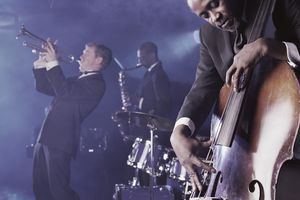 Jazz Band Playing Onstage in a Nightclub, Musician Plucking a Double Bass