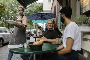 Waitress Wearing Face Mask Serving Food