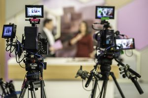 Two cameras filming a TV-show