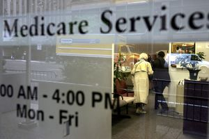 Older woman and aide in Medicare office