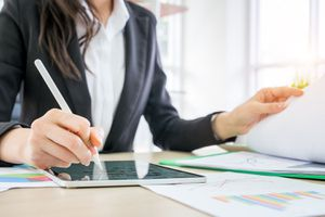 Businessman checking focus revenue with report chart