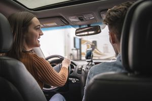 Millennial adult driving a car