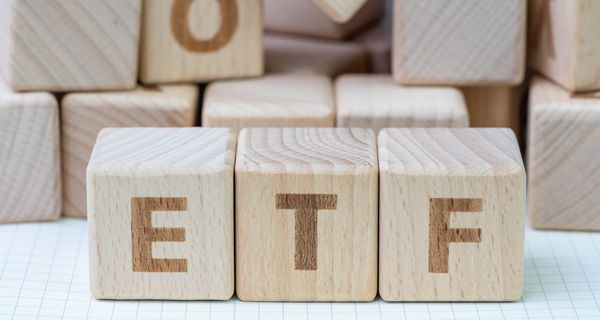 Cube wooden blocks with alphabet building the word ETF.