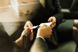 Businessman and woman exchanging business cards