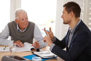 Two men discussing a tax audit