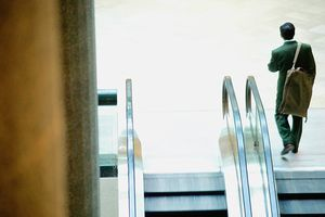 Office building, man next to escalator