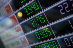 A digital display LED board with currency exchange rates.