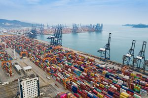 Aerial view of a container port with hundreds of containers