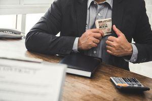 Businessman Keeping Japanese Yen Money Into Suit Pocket
