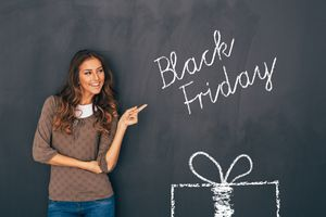 A beautiful woman standing in front of a blackboard and pointing at