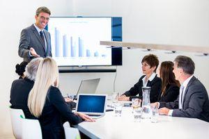Senior Businessman Business Meeting Financial Presentation