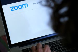 In this photo illustration, the website of Zoom Video Communications Inc is seen on April 4, 2020.