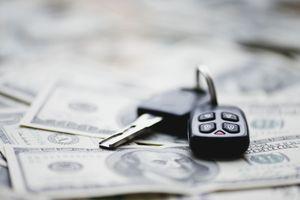 Car key on a pile of dollars